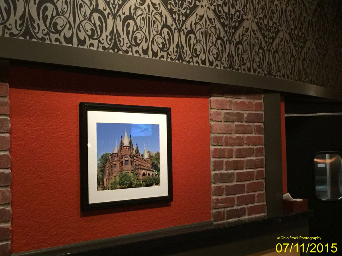 Framed photo of an historic building, hanging in a local restaurant.