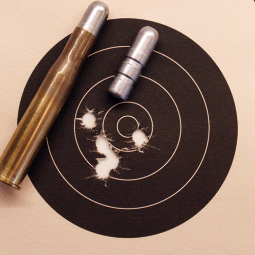 50 yard .450/400 group, also showing cartridge and bullet.