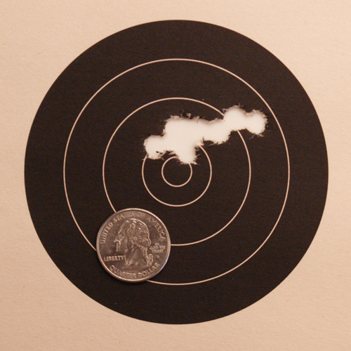 50 yard group shot with heat treated bullets. A quarter is shown to illustrate size.