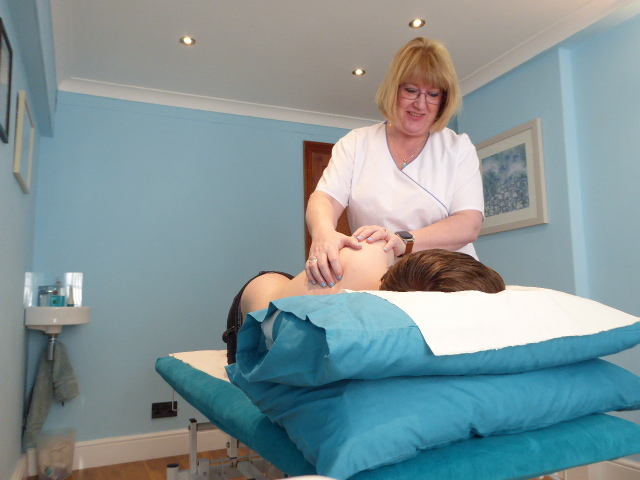 louise cameron osteopath in the treatment room